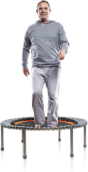 An older man casually walks on his bellicon® mini trampoline