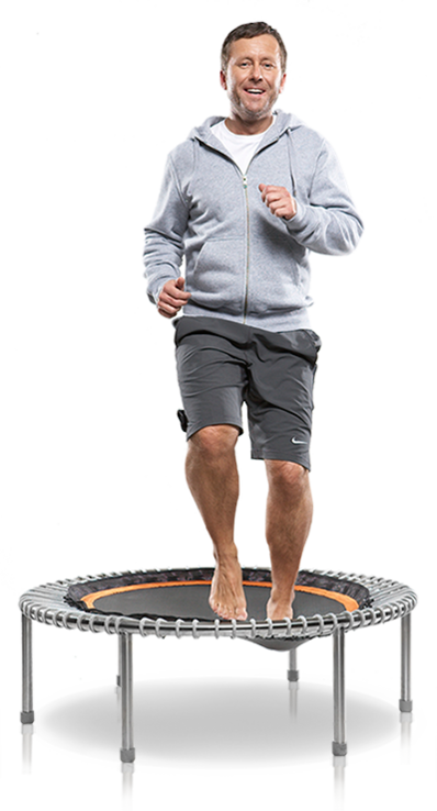 a man in his mid fifties training on a bellicon® mini trampoline