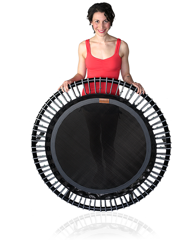 A woman stands smiling behind a bellicon® mini trampoline