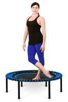 Woman building core strength with a fitness trampoline