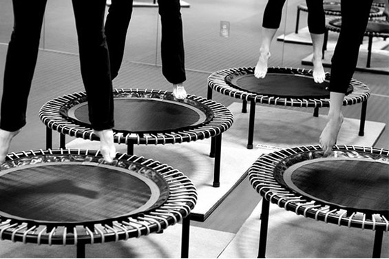 A picture of a class of particants jumping on bellicon® trampolines in a studio