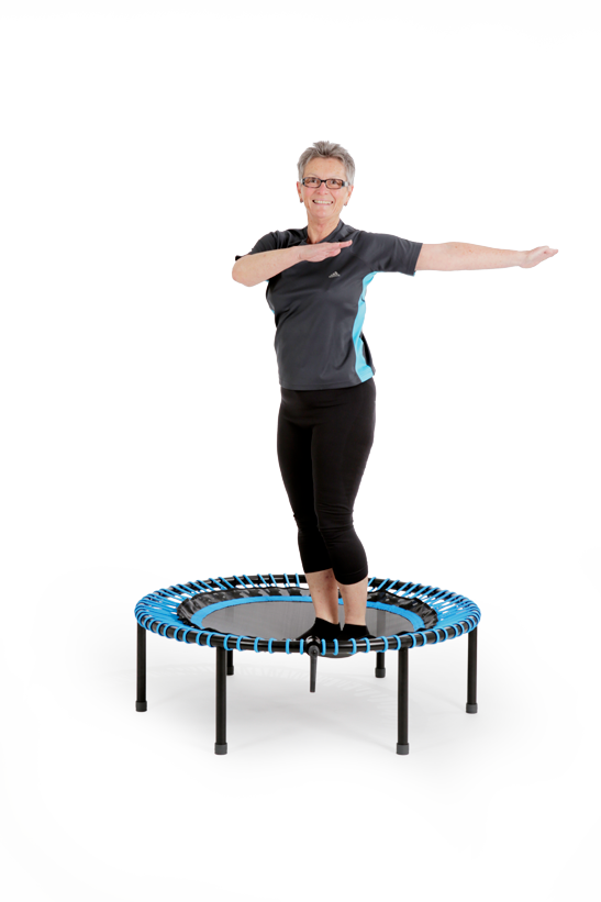 Woman doing a springless trampoline workout