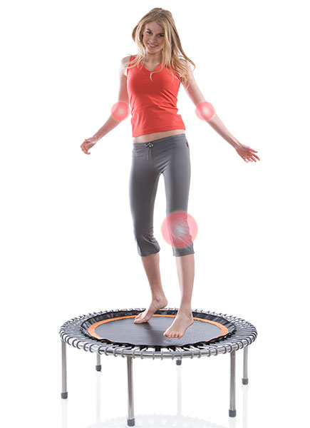 A woman bounding on a bellicon® mini trampoline
