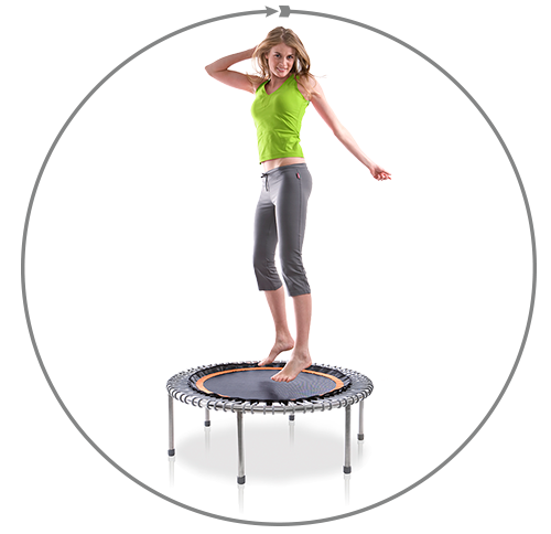 Woman jumps on a mini trampoline