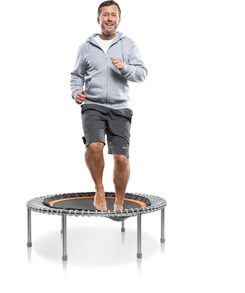 A man gently bounds on a bellicon® mini trampoline