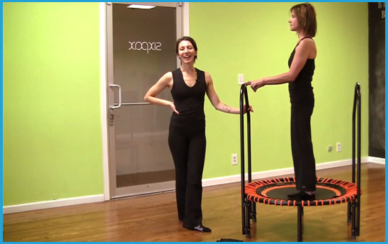 a smiling therapist instructs her on a bellicon® standing client