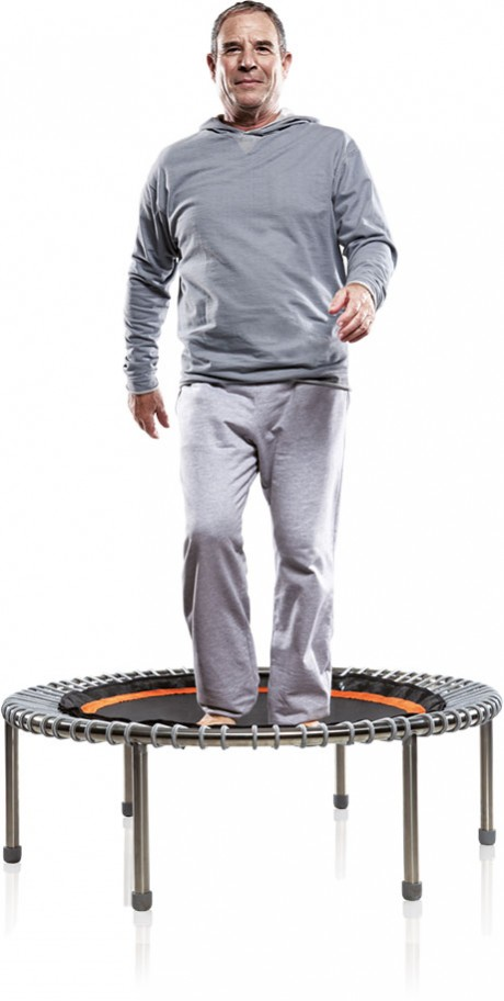 An older man exercising on a bellicon® mini trampoline