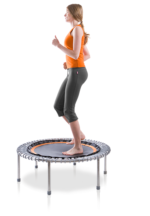 A woman jogs on a bellicon® mini trampoline