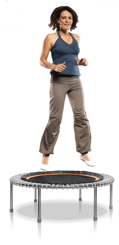 A woman of about 50 in a sport outfit jumping on a bellicon® Premium