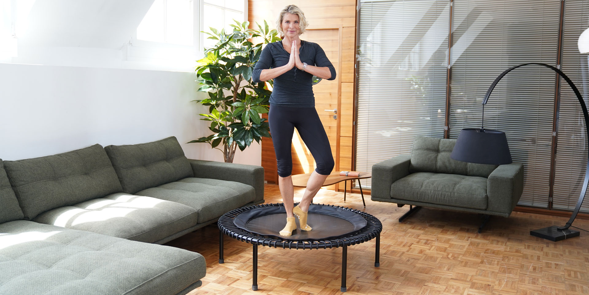 Woman on mini trampoline