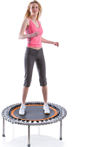 A young woman exercises on a bellicon® premium mini trampoline