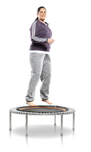 A woman bounding on a bellicon® mini trampoline as a warm up