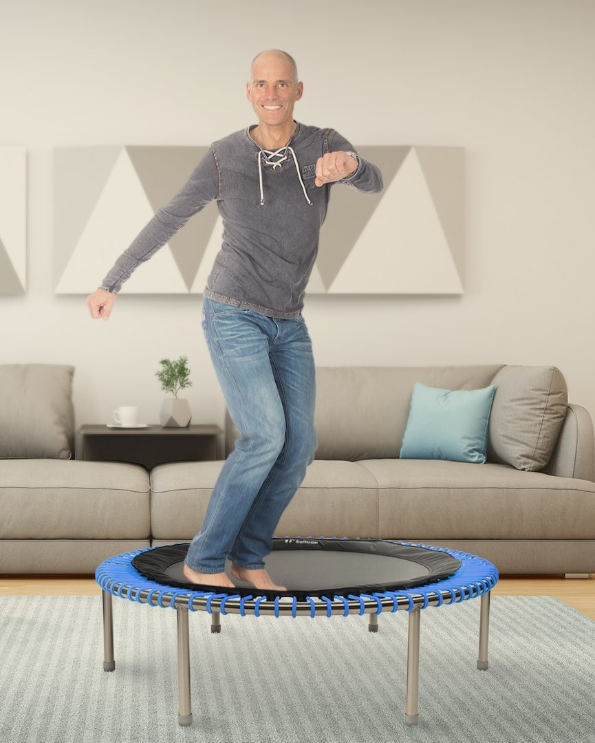 man bouncing on mini trampoline