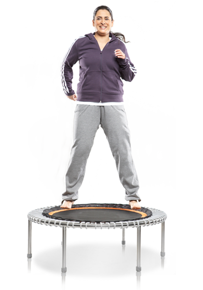 An overweight woman exercises on a bellicon® mini trampoline