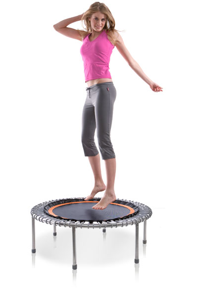 a woman casually bounding on a bellicon® mini trampoline