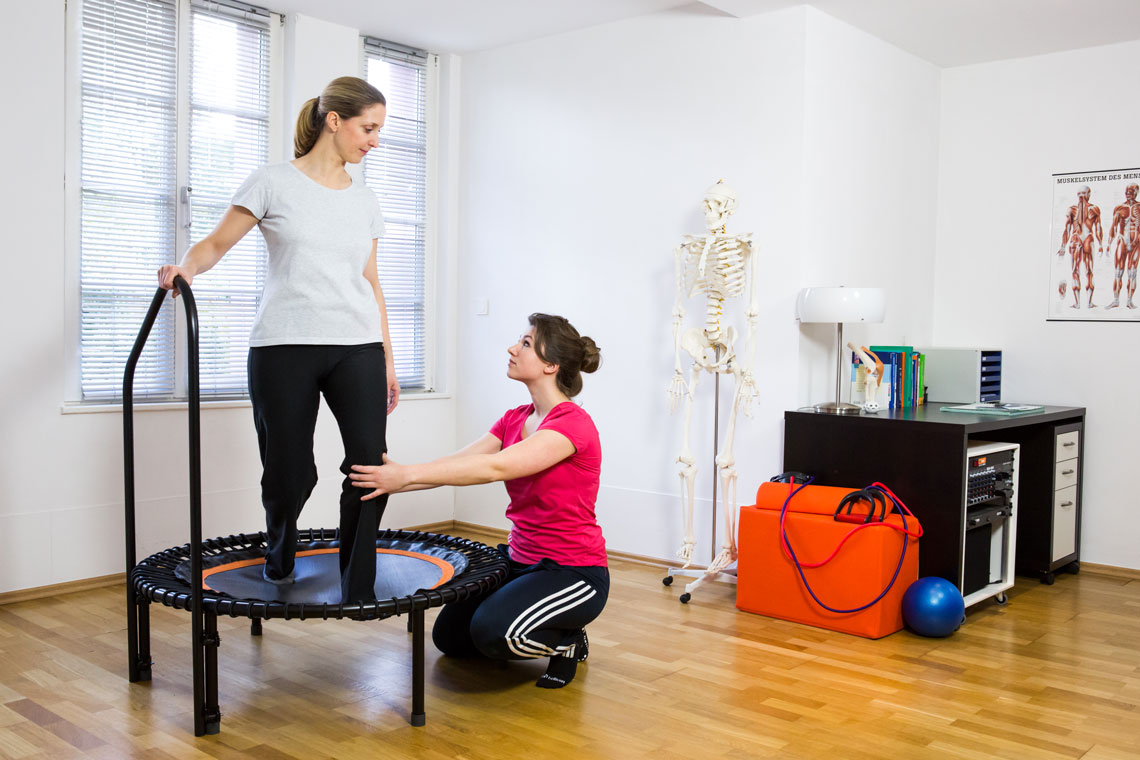Woman receiving advice on how to use her rebounder safely