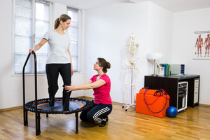 Woman receiving advice on using her rebounder safely